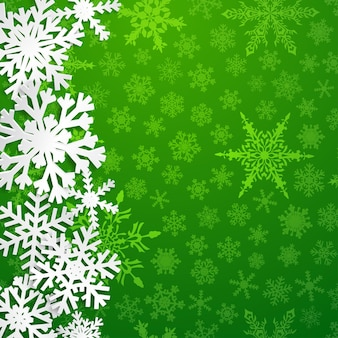 Kerstillustratie met grote witte sneeuwvlokken met schaduwen op groene achtergrond