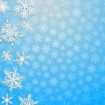 Kerstillustratie met grote witte sneeuwvlokken met schaduwen op lichtblauwe achtergrond