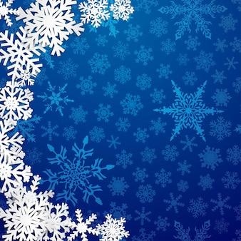 Kerstillustratie met halve cirkel van grote witte sneeuwvlokken met schaduwen op blauwe achtergrond