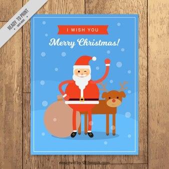 Kerstkaart met de kerstman en een rendier in plat design