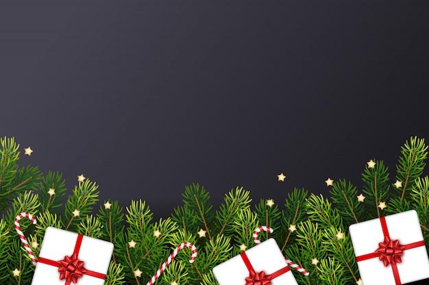 Kerstkaart met geschenken, takken, snoep stokken