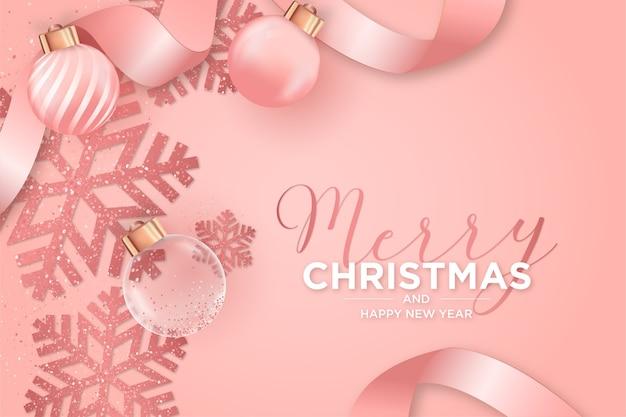 Kerstkaart met roze decoratie van kerstmis