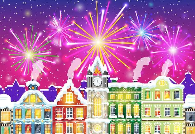 Kerstkaart met stedelijk landschap en vuurwerk.