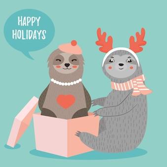 Kerstkaart met twee grappige luiaards jongen en meisje