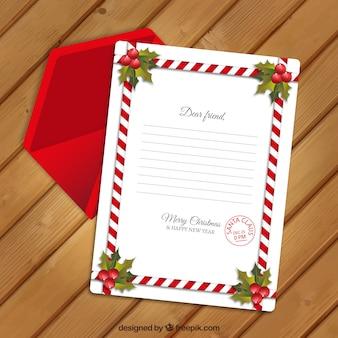 Kerstkaart sjabloon met decoratieve rand en rode envelop