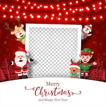 Kerstkaart van fotolijst met de kerstman en vrienden