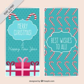 Kerstkaarten met geschenken en zuurstokken Gratis Vector