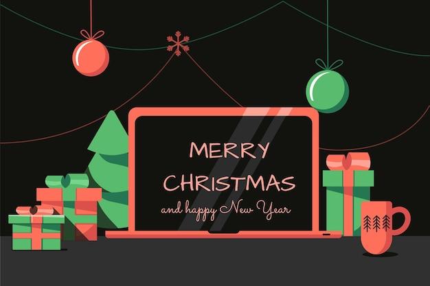 Kerstkantoortafel een laptop met nieuwjaarswensen op de schermgeschenken en een donkere achtergrond
