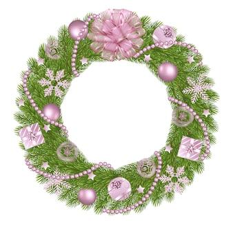Kerstkrans met dennentakken en roze decoraties