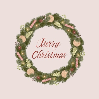 Kerstkrans met snoepjes en pijnboombladeren