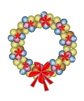 Kerstkrans van kerstballen en rode strikken