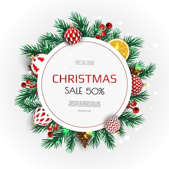 Kerstkrans van kerstballen, sneeuwvlokken en andere vakantie-elementen.