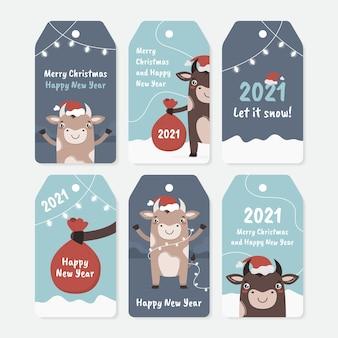 Kerstlabels en labels voor geschenken in het nieuwe jaar. leuke set kaartjes om af te drukken met stier of os