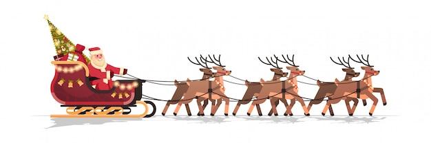 Kerstman in slee met rendieren in de wintervakantie van de kerstmisgroetkaart
