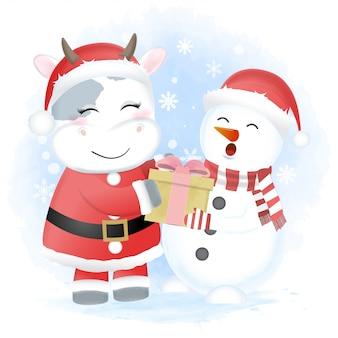 Kerstman koe en sneeuwpop geschenkdoos houden