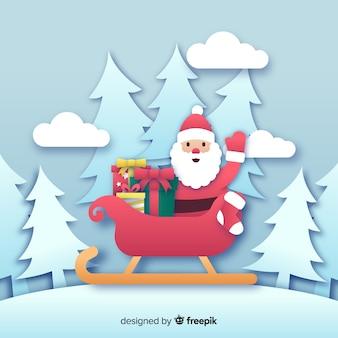 Kerstman op slee in papierstijl