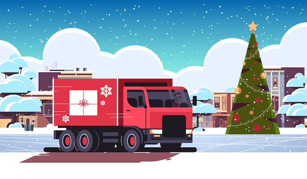 Kerstman rijden bestelwagen met geschenkdoos container verzending vervoer voor vrolijk kerst winter vakantie viering concept horizontale besneeuwde stadsgezicht platte vectorillustratie