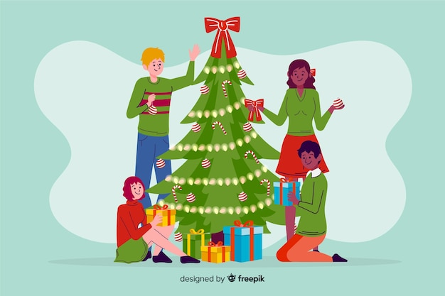 Kerstmensen versieren boom