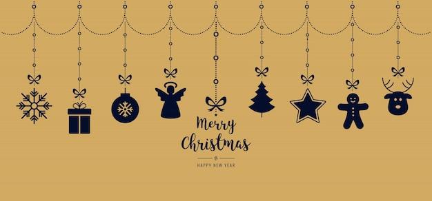 Kerstmis die gouden ornamentelementen hangen die achtergrond hangen