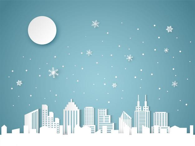 Kerstmis en gelukkig nieuwjaar blauwe achtergrond met stadsgezicht en sneeuwvlok