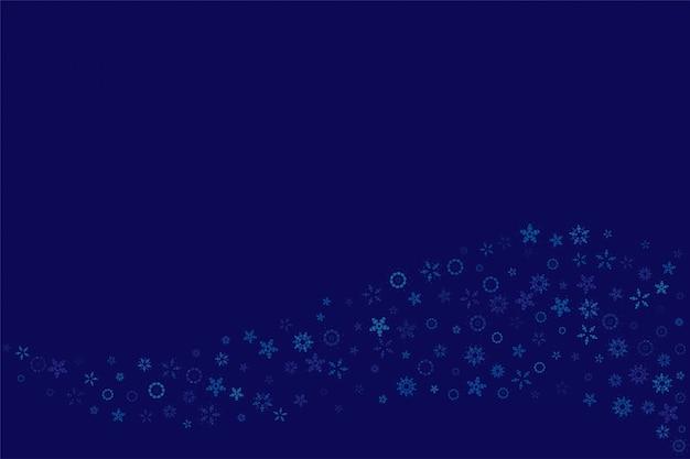 Kerstmis en nieuwjaar achtergrond met sneeuwvlokken op een blauwe achtergrond.
