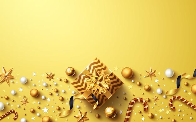 Kerstmis en nieuwjaar gouden achtergrond met gouden geschenkdoos en kerstversiering