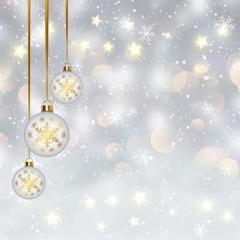 Kerstmis met hangende snuisterijen op een ontwerp van bokehlichten Gratis Vector