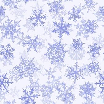 Kerstmis naadloos patroon met complexe grote en kleine sneeuwvlokken, blauw op witte achtergrond