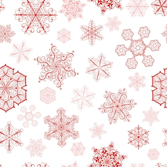 Kerstmis naadloos patroon met grote en kleine rode sneeuwvlokken op witte achtergrond