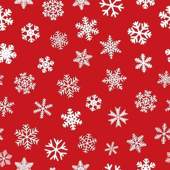 Kerstmis naadloos patroon van sneeuwvlokken, wit op rood.