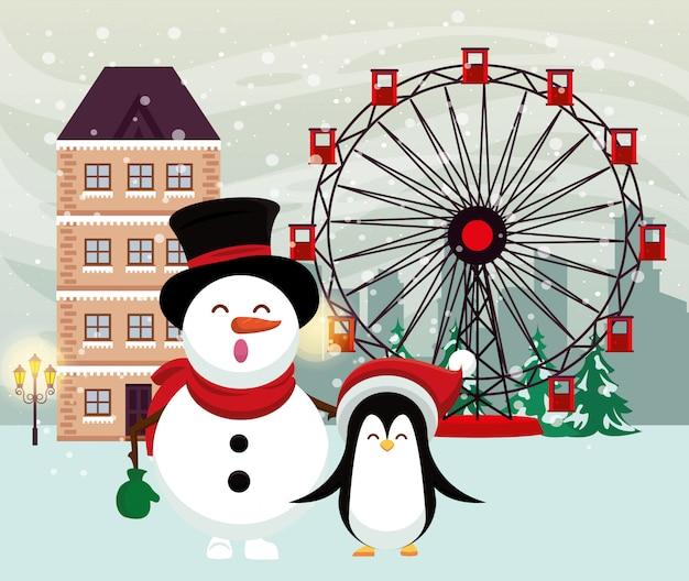 Kerstmis snowscape scène met sneeuwman en pinguïn