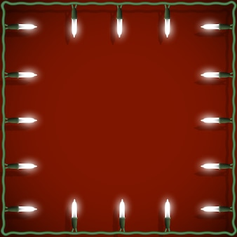 Kerstmis steekt frame op rode achtergrond aan
