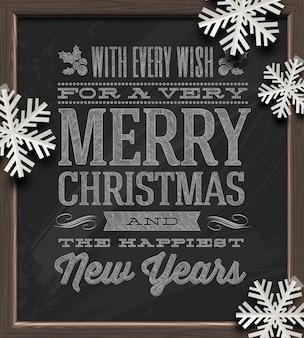 Kerstmis - vakantiegroeten op een schoolbord en witboeksneeuwvlokken