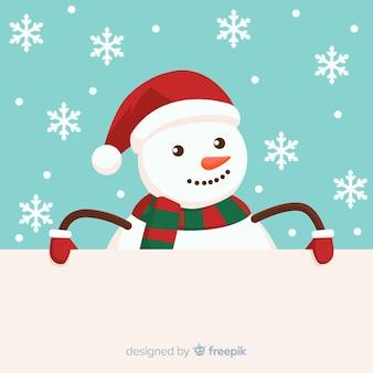 Kerstmisachtergrond die uit sneeuwman piept