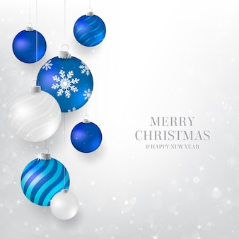 Kerstmisachtergrond met blauwe en witte kerstmissnuisterijen