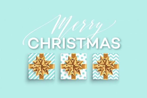 Kerstmisachtergrond met giftendozen met een gouden boog.