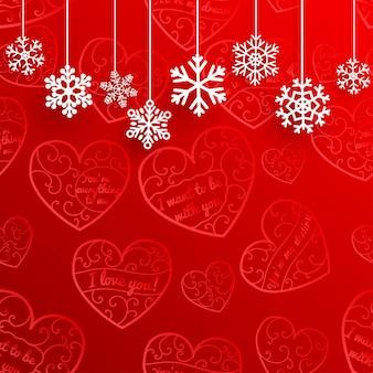 Kerstmisachtergrond met hangende sneeuwvlokken op achtergrond van harten in rode kleuren