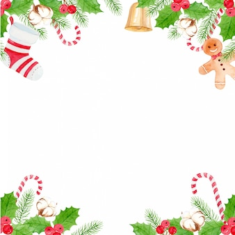 Kerstmisachtergrond met katoenen bloem, gemberbrood, snoepgoed, kerstsokken, bel en hulstbessen