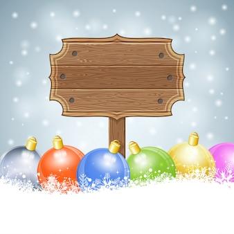 Kerstmisachtergrond met leeg houten teken