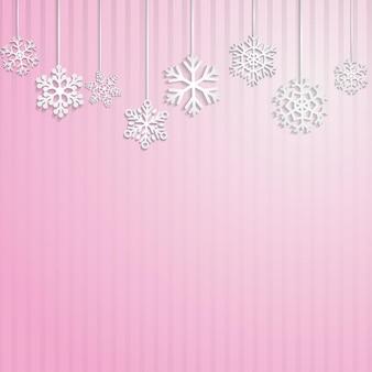 Kerstmisachtergrond met verscheidene hangende sneeuwvlokken op roze gestreepte achtergrond