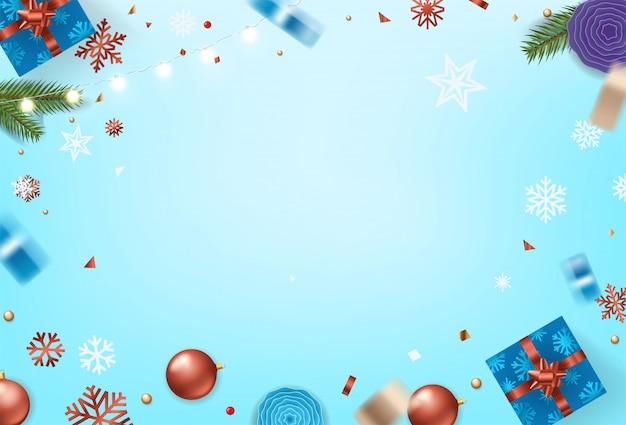 Kerstmiselementen op blauwe lijstachtergrond