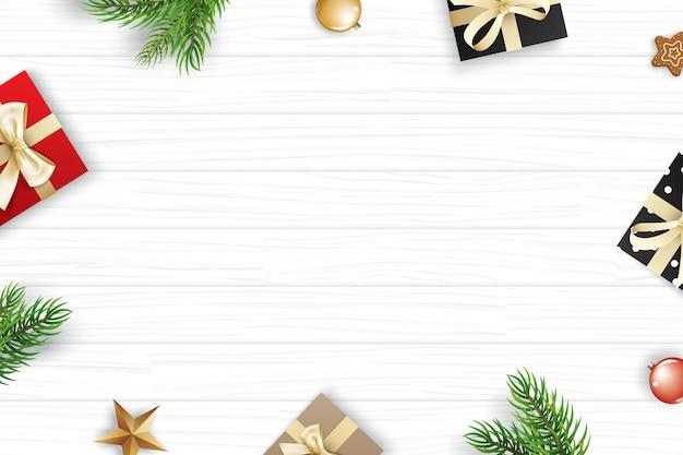 Kerstmiskader met exemplaar copyspace op witte houten achtergrond.