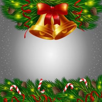 Kerstmisklokken en suikergoedriet op grijze achtergrond