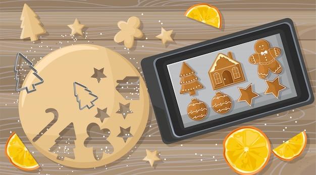 Kerstmislijst met het deeg van peperkoekkoekjes en metaalvormen