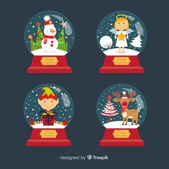 Kerstmissneeuwbal met karakters wordt geplaatst die