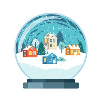 Kerstmissneeuwbol met kleine huizen