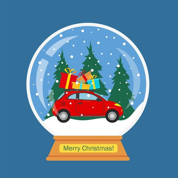 Kerstmissneeuwbol met rode auto en winterlandschap