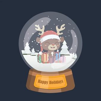 Kerstmissneeuwbol met schattig rendier en cadeautjes binnenin