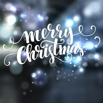 Kerstmistekst op bokehachtergrond, groetkaart