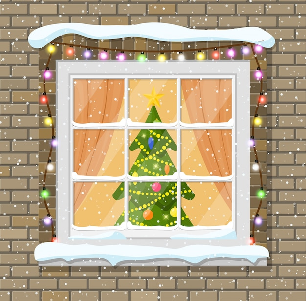 Kerstmisvenster in bakstenen muur.